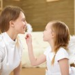 Mother with teenager daughter at home — Stock Photo #4737635