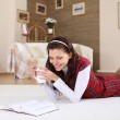A young girl with a mug top at home — Stock Photo #4737646