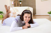 A young girl with at home relaxing on the carpet — Stock Photo