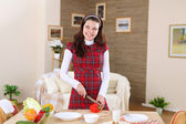 A young girl cooking at home — Stockfoto