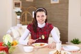 Young girl eating healthy food at home — Stock Photo