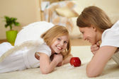 Girl and her mother with a present — Stock Photo