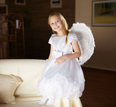 Girl in white dressed as an angel — Stock Photo