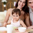 Stock Photo: Young family at home having meal