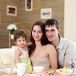 Young family at home having meal — Stock Photo #4870327