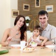 Young family at home having meal — Stock Photo #4870478