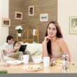 Foto Stock: Young mother at home having meal