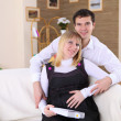 Pregnant wife and her husband at home - Stock fotografie