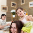 Young mother playing with her baby at home — Stock Photo #4873737