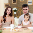 Young family at home having meal — Stock Photo #4899633