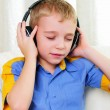 A boy in studio with headphones — Stock Photo