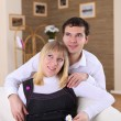 Young couple at home - Stockfoto