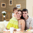 Young family at home having meal — Stock Photo #4924843