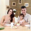 Young family at home having meal — Stock Photo #4924993