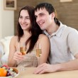 Young couple at home having meal — Stock Photo
