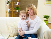 Little boy and his mother at home together — Stock Photo