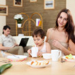 Young family at home having meal — Stock Photo