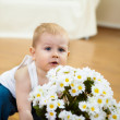 Little boy with flowers — Stock Photo #4931168