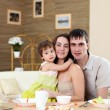 Young family at home having meal — Stock Photo #4931191