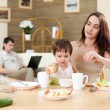 Young family at home having meal — Stock Photo #4931281