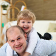 Father and son playing on the floor at home — Stock Photo