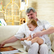 Portrait of grandfather and granddaughter - Stock Photo