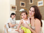 Young mother playing with her baby at home — Stock Photo