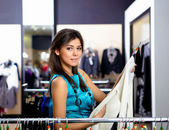 Young woman in a shop buying clothes — Photo