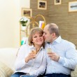 Couple at home drinking champagne — Stock Photo #4944817