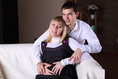 Pregnant wife and her husband at home — Stock Photo