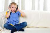 A boy in studio with headphones — Stockfoto