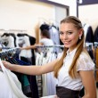 Young woman in a shop buying clothes — Stock Photo #4963785