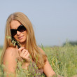 Woman with glasses in the field — Stock Photo