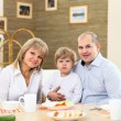 Stock Photo: Family having meal at home