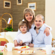 Family having meal at home — Stock Photo #4983779