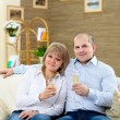 Couple at home drinking champagne — Stock Photo #4983911