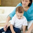Stock Photo: Mother and son at home on the floor