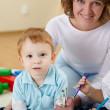 Mother and son at home on the floor — Stock Photo #4990430
