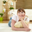 Young woman relaxing at home on the floor — Stock Photo #5018459