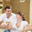 Couple at home drinking champagne — Stock Photo #5018541