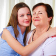 A grandmother with her young granddaughter — Stock Photo