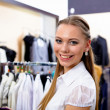 Young woman in a shop buying clothes — Stock Photo #5090599