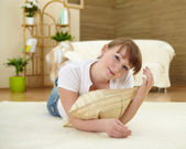 Young woman relaxing at home on the floor — Stock Photo