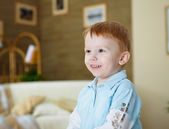 Happy smiling and laughing boy at home — Stock Photo