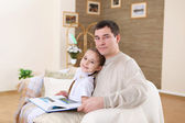 Father with his daughters at home — Stock Photo