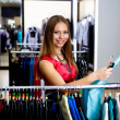 Young woman in a shop buying clothes — Stock Photo #5154838