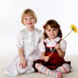 Two little girls on the floor — Stock Photo