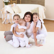A young mother with her three daughters at home — Stock Photo #5154998
