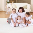 A young mother with her three daughters at home — Stock Photo #5155012