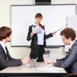 A young business woman making presentation - Stock Photo